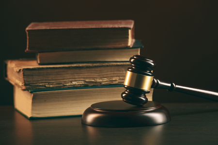 Judge gavel and legal book on wooden table, justice and law