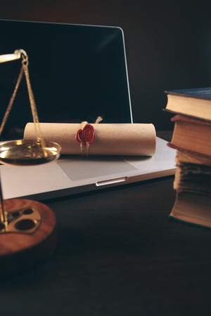 justice and law concept.Lawyer workplace with laptop and documents with dark wooden Banque d'images - 118150256
