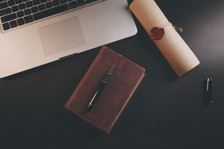 justice and law concept. Lawyer workplace with laptop and documents with dark wooden. Notarys public pen and stamp on testament and last will. Stock Photo