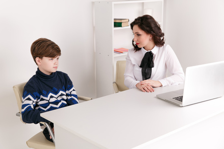 Teen boy talking to his therapist. Social worker and patient.
