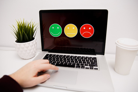 man putting on excellent smiley face rating for a satisfaction survey, Customer experience