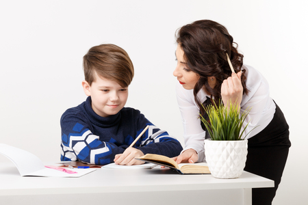 Teacher and student working together and getting new information. Stockfoto