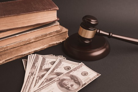 Judge wooden gavel with dollar money banknote concept for bribery Stock Photo