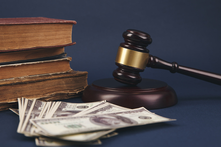 Judge Gavel, Scale Of Justice With USa Dollars And Law Book On Judges Table In Courtroom. Conceptual Image To Illustration Bail, Bankruptcy, Fee, Tax, Fraud, Monetary Penalty, Fine And Financial