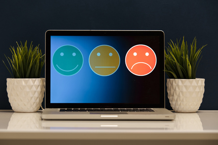putting on excellent smiley face rating for a satisfaction survey, Customer experience Stock Photo - 119192627