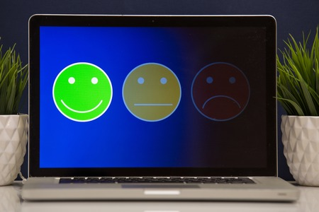 putting on excellent smiley face rating for a satisfaction survey, Customer experience Stock Photo - 119192715
