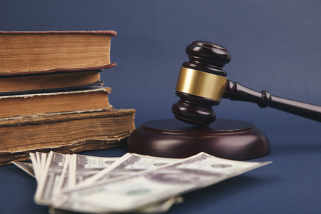 Judge wooden gavel with dollar money banknote concept