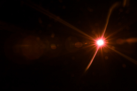 abstract lens flare red light over black background Stock Photo