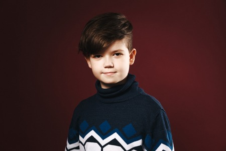 Portrait of teen age boy isolated over the pink background.