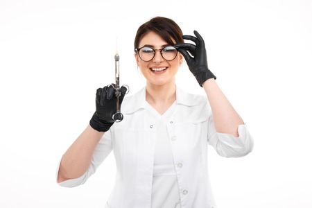 Closeup photo of female dentist in black gloves and glasses with dental stuff isolated over the withe backgrownd.