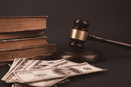 Judge wooden gavel with dollar money banknote concept for