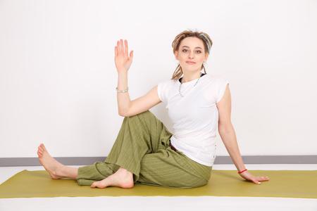 Yoga time. Doing asana in the studio. Stock Photo