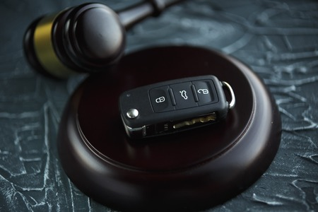 Car auction concept - gavel and car key on the wooden Reklamní fotografie