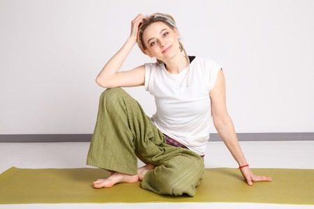 Cute young woman doing yoga. Asana.