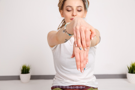 Closeup photo demonstrating hands yoga. Female yogi.