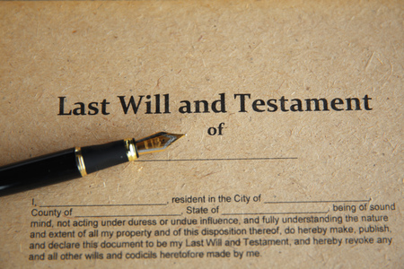 Notarys public pen and stamp on testament and last will. Notary public Stock Photo