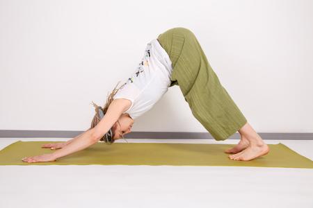 Cute young woman doing yoga. Asana. Stock Photo