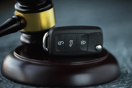 Car auction concept - gavel and car key on the wooden Stock Photo