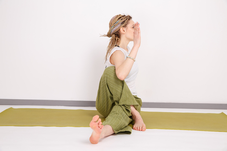 Female model in yoga pose in the studio. Young woman doing exercises. Relax Stockfoto