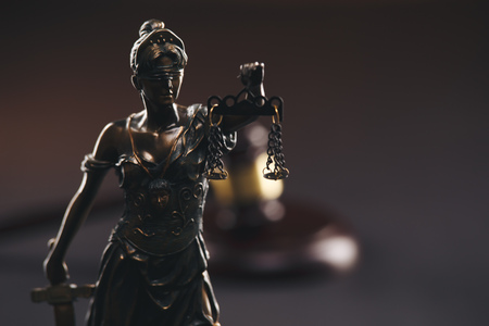Judje gavel and statue of Justice isolated.
