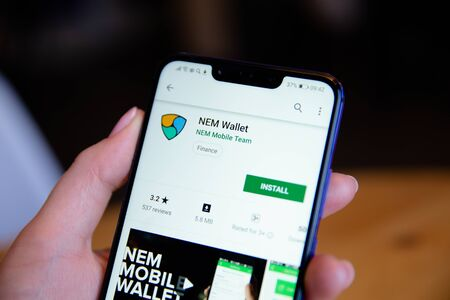 Tula, Russia - March 25, 2019: Nem Wallet on phone display. Editorial