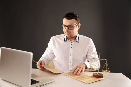 Man lawer working with contract papers. Attorney concept. Stock Photo