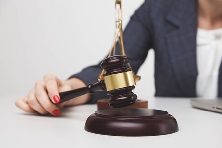 Woman notary with wooden gavel isolated,