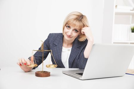 Woman jurist working laptop in office isolated. 免版税图像