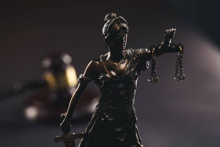 Judje gavel and statue of Justice isolated Stock Photo