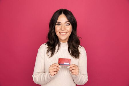 Advertising concept. Lady smiling and showing credit card isolated. Stock Photo