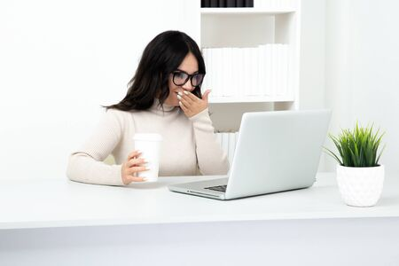 Exhausted and stressed female sitting in office isolated.