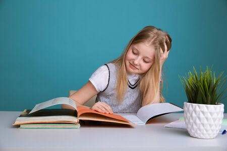 education and school concept - smiling little student girl with many books at school 写真素材