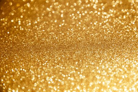 Gold glittering christmas lights. Blurred abstract background Stockfoto