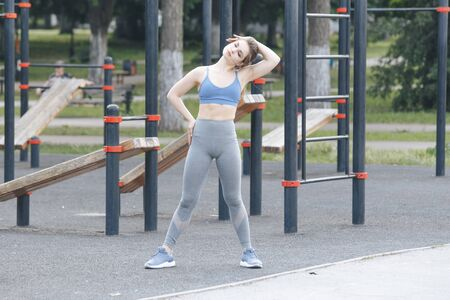 Sporty woman on a street workout. Training outdoor concept.