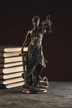 Attorney and notary concept. Books and Statue of Justice isolated