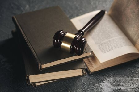 Wooden gavel on the table with notary books