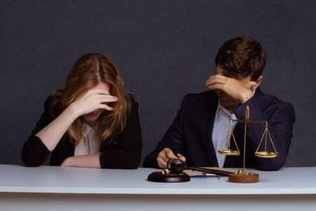 Couple going through divorce signing papers.