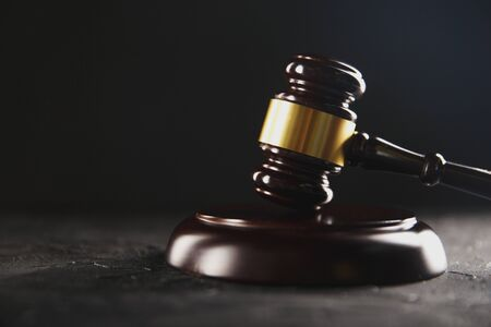 Law and justice concept. Dark gavel on the wooden table. Фото со стока
