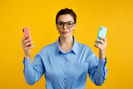 conversion funnel, A B test in marketing and online advertising. Brunette woman holding colored letters A and B in hands with face expression Stock Photo