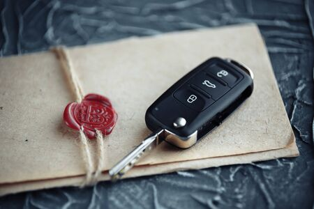 car key and envelope on the desk Stock Photo