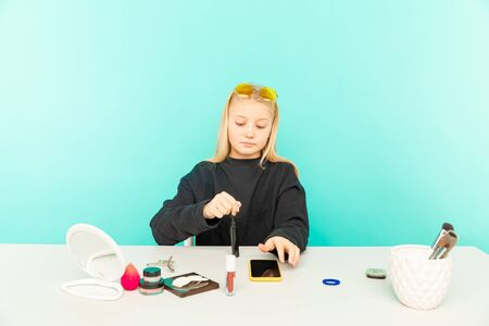 Girl beauty blogger. Blond teen posing on camera and making vlog. Stock Photo