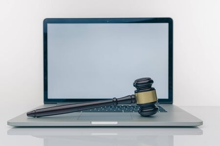 Workspace of lawyer with laptop blank white screen and law wooden gavel,legal book and brass scale of judge. lawyer and law ,judiciary and legislature courtroom legal concept