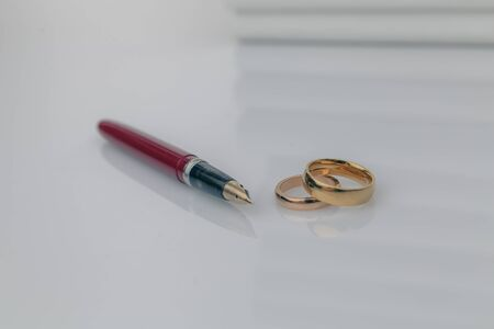 Couple with divorce contract and ring on desk. Divorce.