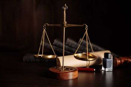 Attorney and notary concept. Wooden gavel on the table and libra
