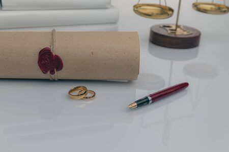 Couple with divorce contract and ring on desk. Divorce