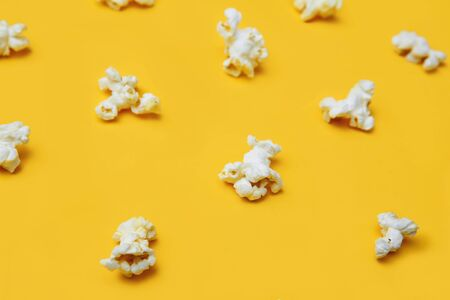 Popcorn pattern on yellow background. Top view. Film. Fast food. Corn