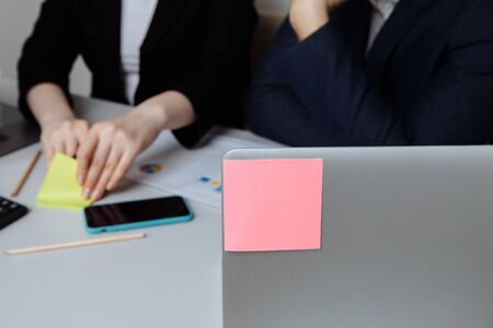 Sticky note on the laptop, place for text. Office concept. Business people meeting design ideas concept