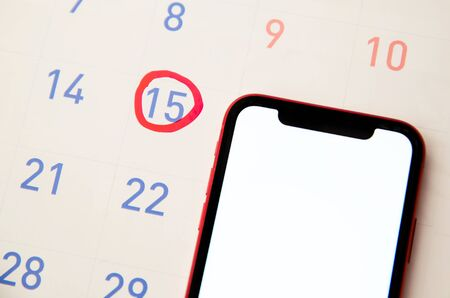 Red highlighter with ovulation day mark on calendar, Concept of fertility chart, trying to have baby and natural contraception