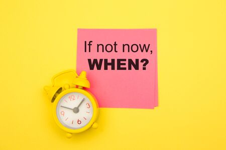 If Not Now When, text on a pink sticker with yellow alarm aside. Motivating and inspiring question