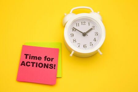Time to action, text on a pink sticker with white alarm aside. Motivating and inspiring question. Archivio Fotografico